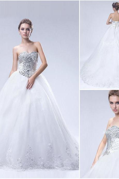 Strapless Sweetheart Beaded Ball Gown Wedding Dress Featuring Lace-Up Back and Long Train