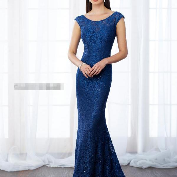 Lace fit and flare gown with scattered hand-beading features cap sleeves, illusion bateau neckline over sweetheart bodice, low square back, sweep train